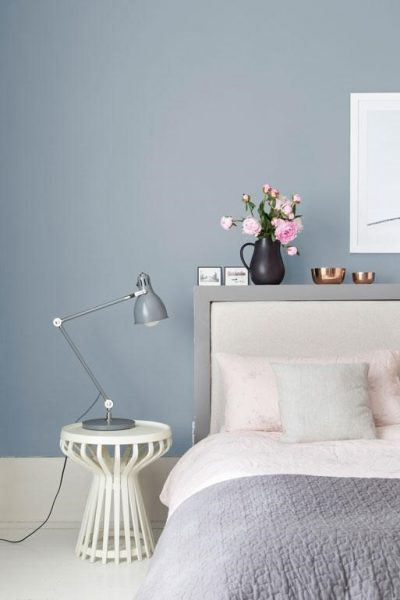 soft blue bedroom with pink and grey bedding with pop of copper