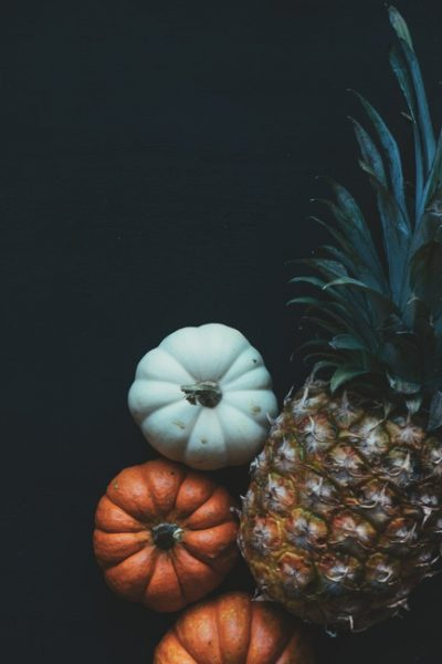 yellow and green pineapple pairs well with orange and white pumpkins
